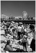 Families on beach and Pacific Park on Santa Monica Pier. Santa Monica, Los Angeles, California, USA (black and white)