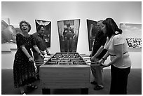 Playing soccer table game in art gallery, Bergamot Station. Santa Monica, Los Angeles, California, USA (black and white)