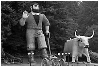 Giant figures of Paul Buyan and cow. California, USA ( black and white)