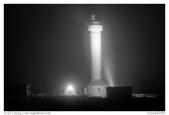 Fog and Point Arena Lighthouse by night. California, USA