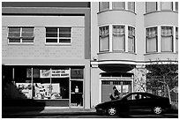 Street with brighly painted buildings, Mission District. San Francisco, California, USA (black and white)