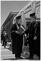 Graduate wearing lei presented with diploma. Stanford University, California, USA ( black and white)