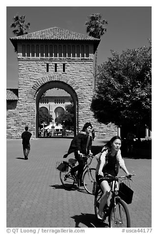 Students riding bicycles through Main Quad. Stanford University, California, USA