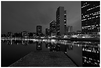 High-rise buildings, deck, and Lake Meritt, dusk. Oakland, California, USA ( black and white)