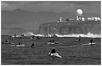 Flottila of personal watercraft near Mavericks break in front of  Pillar Point air force station. Half Moon Bay, California, USA (black and white)