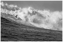 Surfing Mavericks. Half Moon Bay, California, USA (black and white)