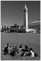 Students on lawn with Campanile in background. Berkeley, California, USA (black and white)