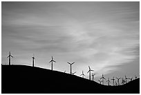 Wind farm silhouetted on hill, Altamont. California, USA (black and white)