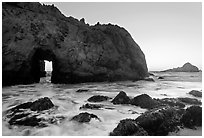 Pfeiffer Beach arch at sunset. Big Sur, California, USA ( black and white)