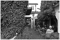 Cafe terrace in alley. Carmel-by-the-Sea, California, USA (black and white)