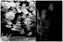 Mother and infant look at Jelly exhibit, Monterey Bay Aquarium. Monterey, California, USA (black and white)