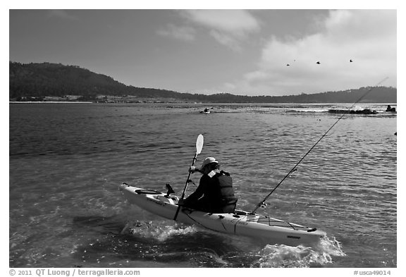 Sea kayaking into Carmel Bay. Carmel-by-the-Sea, California, USA (black and white)