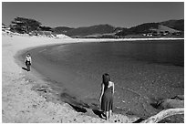 Women stroll on Carmel River Beach. Carmel-by-the-Sea, California, USA ( black and white)