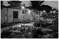 Garden and historic adobe house at night. Monterey, California, USA (black and white)
