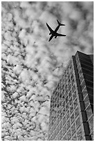 Adobe Tower and commercial aircraft. San Jose, California, USA (black and white)
