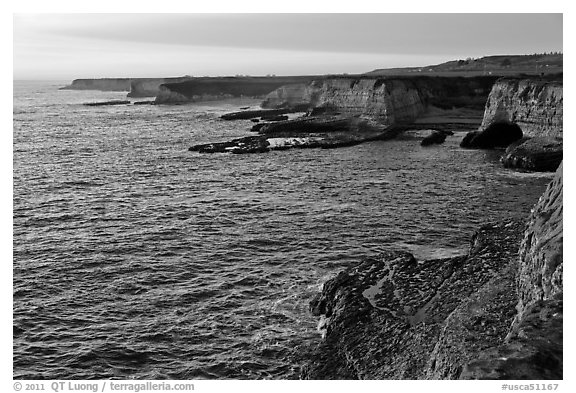 Sandstone sea cliffs at sunset, Wilder Ranch State Park. California, USA (black and white)