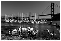Horseshoe Bay, canoes, yachts and Golden Gate Bridge. California, USA ( black and white)