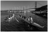 Outrigger canoes and Golden Gate Bridge. California, USA ( black and white)
