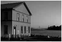 Tiburon Road-Ferry museum and Golden Gate Bridge at sunset. California, USA ( black and white)