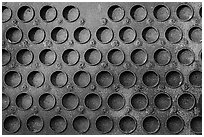 Grid of holes in metal, Shipyard No 3, Rosie the Riveter Front National Historical Park. Richmond, California, USA (black and white)