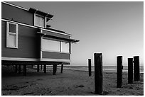 Pilings and beach house at sunset, Stinson Beach. California, USA ( black and white)