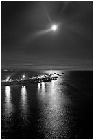 Moon and fishing pier by night. Capitola, California, USA (black and white)