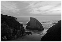 Offshore rock at sunset, Davenport. California, USA (black and white)