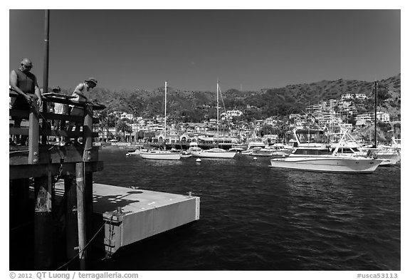 Fishing from Avalon pier, Santa Catalina Island. California, USA (black and white)