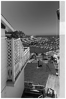Harbor seen from between hillside houses, Avalon, Catalina. California, USA ( black and white)