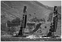 Emirates Team New Zealand leeward of Oracle Team USA at first mark. San Francisco, California, USA (black and white)