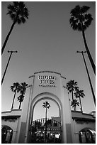 Entrance gate at dusk, Universal Studios. Universal City, Los Angeles, California, USA ( black and white)