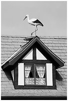 Stork on roof window. Solvang, California, USA ( black and white)