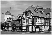 Half-timbered buildings and windmill. Solvang, California, USA ( black and white)