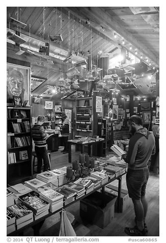 Visitors browsing books, Henry Miller Memorial Library. Big Sur, California, USA (black and white)