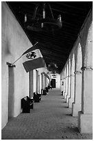Outside arcade with Mexican and Spanish flags. California, USA ( black and white)