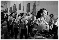Mexican worshippers during festival, Mission San Miguel. California, USA ( black and white)