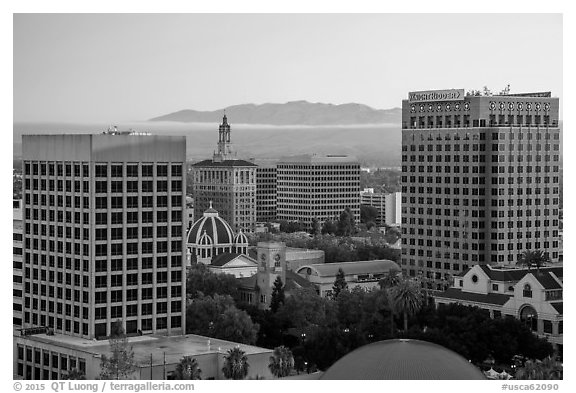 San Jose skyline at sunrise with fog over hills. San Jose, California, USA (black and white)