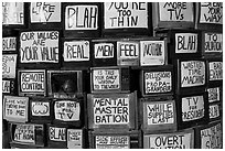 Wall of televisions covered with slogans, Slab City. Nyland, California, USA ( black and white)