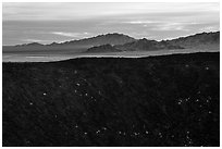 Amboy Crater rim and mountains. Mojave Trails National Monument, California, USA ( black and white)