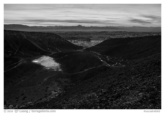 Interior of Amboy Crater with breach in the cinder cone rim at sunset. Mojave Trails National Monument, California, USA (black and white)