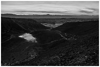 Interior of Amboy Crater with breach in the cinder cone rim at sunset. Mojave Trails National Monument, California, USA ( black and white)