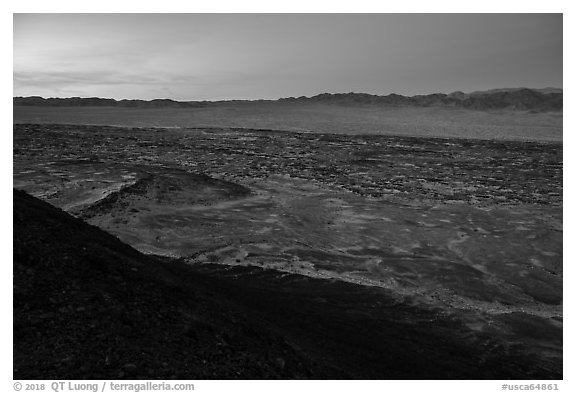 Lava field and mountains from Amboy Crater at dusk. Mojave Trails National Monument, California, USA (black and white)