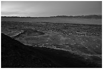 Lava field and mountains from Amboy Crater at dusk. Mojave Trails National Monument, California, USA ( black and white)