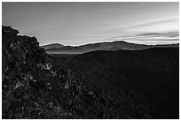 Rim of Amboy Crater and mountains at dusk. Mojave Trails National Monument, California, USA ( black and white)