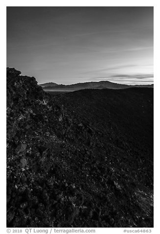 Interior slopes of Amboy Crater and mountains at dusk. Mojave Trails National Monument, California, USA (black and white)