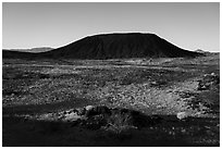 Lava field and Amboy Crater cinder cone. Mojave Trails National Monument, California, USA ( black and white)