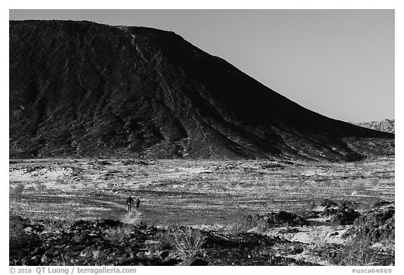 Hikers on Western Cone Trail, Amboy Crater. Mojave Trails National Monument, California, USA (black and white)