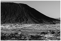Hikers on Western Cone Trail, Amboy Crater. Mojave Trails National Monument, California, USA ( black and white)