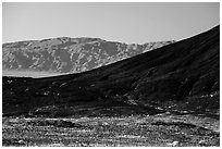 Amboy Crater slope and mountains. Mojave Trails National Monument, California, USA ( black and white)