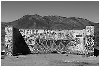 Abandonned building with graffiti along route 66. Mojave Trails National Monument, California, USA ( black and white)